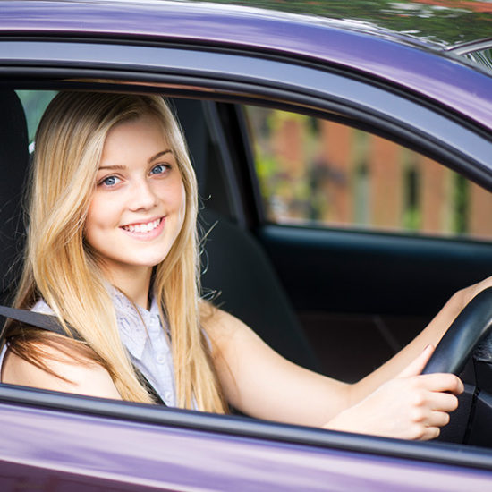 young woman or girl learning to drive with learner driver insurance by Insure Smart