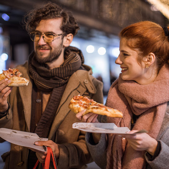 Couple eating pizza and takeaway insurance by Insure Smart