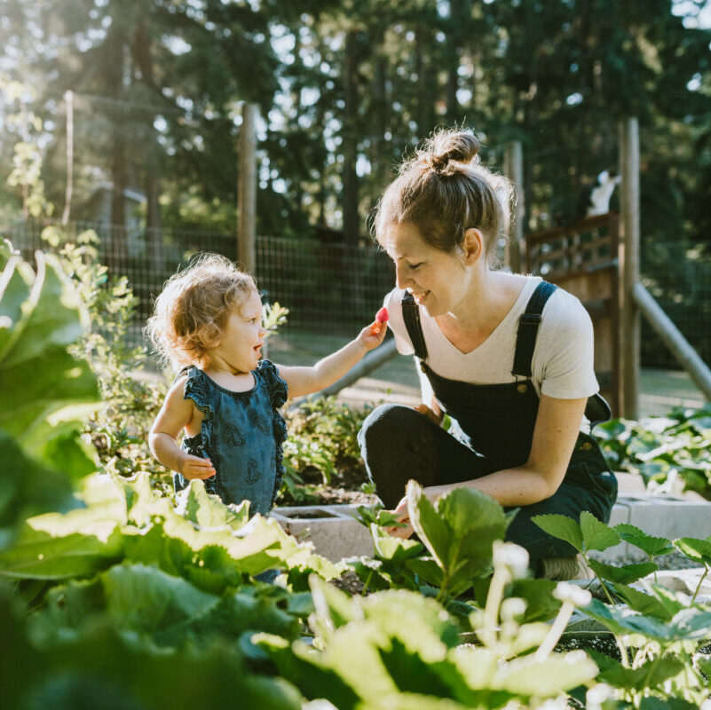Mother and daughter playing in the garden, protected with Life Insurance cover from Insure Smart